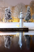 Snow on trees in Riga park and lighthouse — Stock Photo