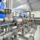 New plastic pipes and colorful equipment in industrial boiler room — Stock Photo