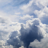 Classic cloudscape. Blue sky with ornamental clouds — Stock Photo