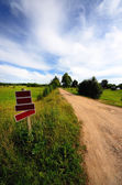 Road with blank roadsigns and a classic rural landscape — Stock Photo