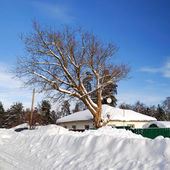 A house in winter with large snowdrifts — Stock Photo