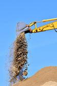 New yellow excavator working on sand dunes. Scoop close-up — Stock Photo