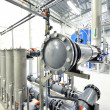 New shiny pipes and large pumps in industrial boiler room — Stok fotoğraf #37436127