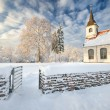 Lutheran church in Latvia in beautiful winter day — Stock Photo