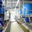 New shiny pipes and large tanks in industrial boiler room — Stock Photo #37437211