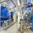 New shiny pipes and large tanks in industrial boiler room — Stock Photo #37437221