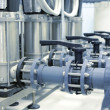 Stock Photo: New shiny pipes in industrial boiler room