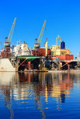 Cargo ship during fixing and painting at the shipyard docks — Stock Photo