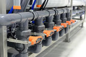 New shiny pipes and colorful equipment in industrial boiler room — Stock Photo