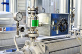 New shiny pipes and a barometer in industrial boiler room — Stock Photo