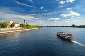 General view on Riga embarkment and river ships in bright sunny — Stock Photo