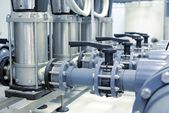 New shiny pipes in industrial boiler room — Stock Photo