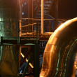New shiny pipes and large tanks in industrial boiler room — Stock Photo