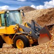 Bulldozer working in sawdust — Stock Photo #38697953