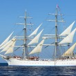 Old historical tall ship with white sails in blue sea — Stock Photo