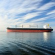 Large cargo ship sailing in still water — Stock Photo