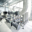 New shiny pipes and large pumps — Stock Photo #42688871