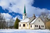 Country side Catholic church in winter — Stock Photo