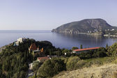 View from the cliff at Cape village of Plaka, the castle of Princess Gagarin and south-eastern part of the Ayu-Dag (Bear Mountain). Crimea. Ukraine — Stock Photo