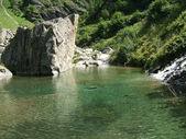 Lake in alpine mountains — Stock Photo