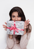 Beautiful girl with christmas present on sale — Stock Photo