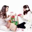 Two smiling women opening christmas presents — Stock Photo