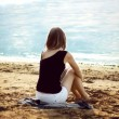 Lonely girl relaxing on the sea beach — Stock Photo