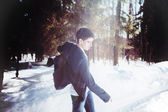 Portrait of a man dancing in snow forest — Stock Photo