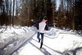 Handsome man dancing on snow background — Stock Photo
