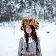 Forest woman with autumn leaves in white snow winter  — Stock Photo