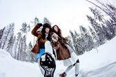Funny women fooling around on white snow winter background fisheye — Stock fotografie