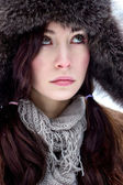 Face of brunette hair woman in fur hat — Stock Photo