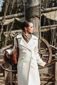 Romantic fashion portrait of a beautiful woman on a ship — Stock Photo