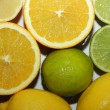 Slices of orange, lime, lemon — Stock Photo