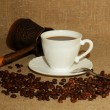 A cup of coffee, coffee beans and a Turk — Stock Photo