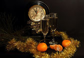 Glasses of champagne, tangerines and Watches — Stockfoto