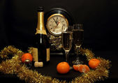 Bottle and glasses of champagne at New Year's Eve — Stok fotoğraf