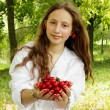 Sweet girl holding a handful of ripe cherry — Stock Photo #37632573