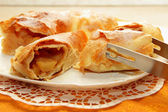 Strudel, cut into chunks and dusted with icing sugar — Stock Photo