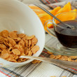 Stock Photo: Flakes in deep plate, cup of coffee and orange, sliced