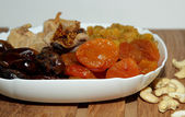 Dried fruits in white plate — Stock Photo