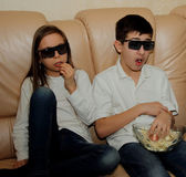 Children look closely at the TV — Stock Photo