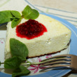 Cottage cheese souffle with raspberry jam and a sprig of mint on the plate — Stock Photo #42116511