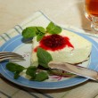 Cottage cheese souffle with raspberry jam and a sprig of mint on the plate — Stock Photo
