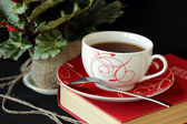 A cup of tea and a book — Stock Photo