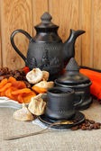 Cup with coffee, coffee pot, and dried fruit — Stock Photo