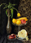 Still life with vase and fruit — Stock Photo
