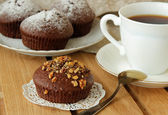 Chocolate cake sprinkled with walnuts cup of hot coffe — Stock Photo