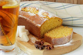 Sponge cake made from corn flour and a cup of tea — Stock Photo