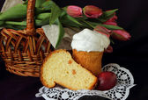 Tulips in the basket, Easter cake and eggs — Stock Photo